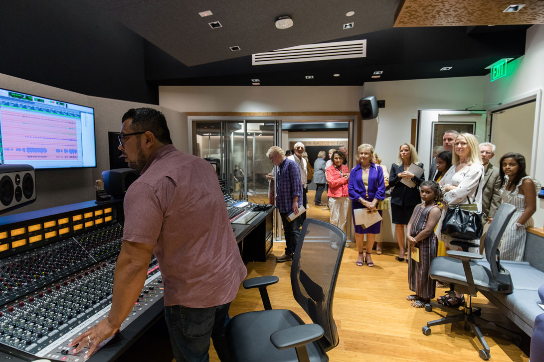 People touring the new recording studio in the BMC