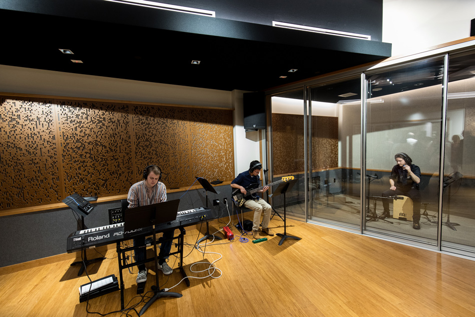Students practicing and using the new recording studio in the BMC