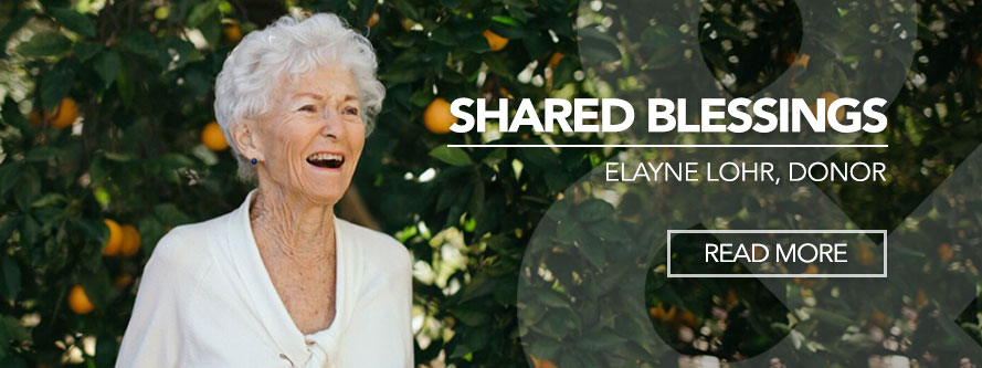 Elayne Lohr laughing with orange trees in background