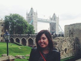 Student posing with the London bridge in the background.