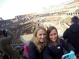 Selfie with the Roman Colosseum in background.