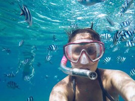 Selfie while snorkeling with fish.