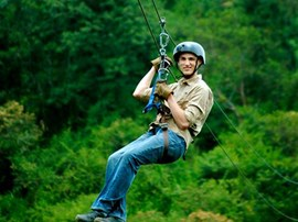 Student zip lining in the jungle.