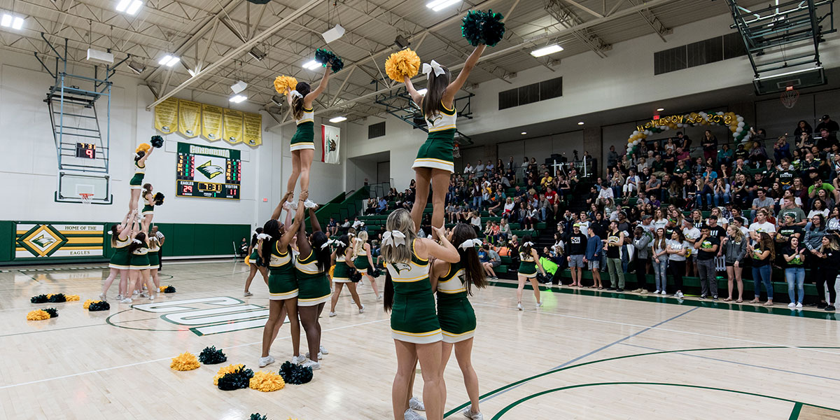 CUI Cheer and Stunt performing for the fans