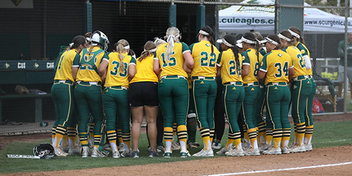 Softball team huddle on the field