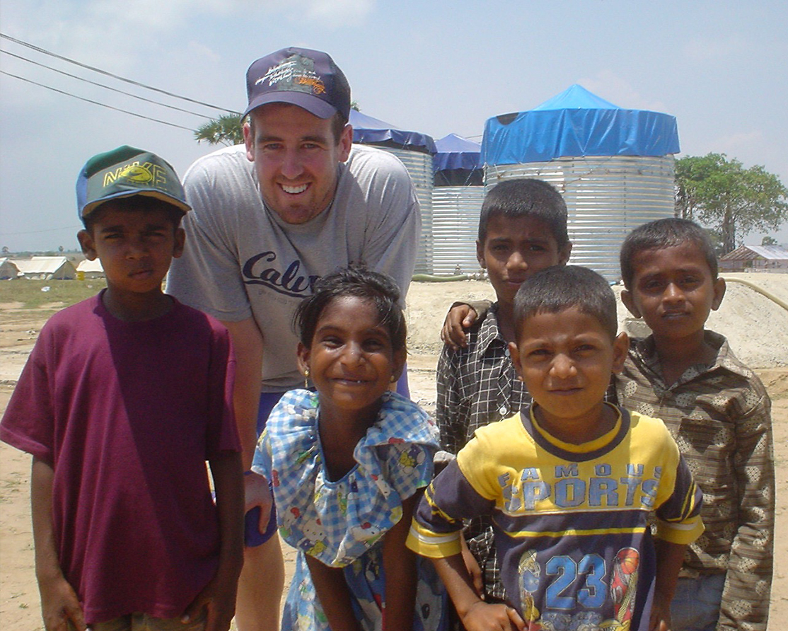 Josiah Walker with children in Sri Lanka