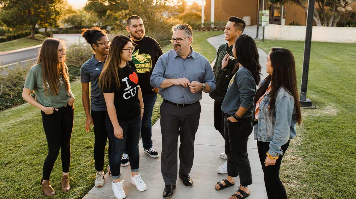 President Thomas with students