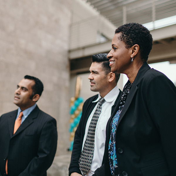 Graduate students outside of Grimm Hall