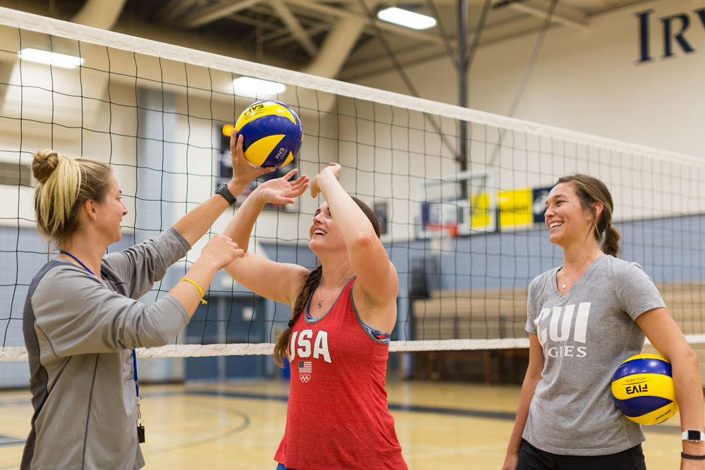 Students being taught how to set in volleyball