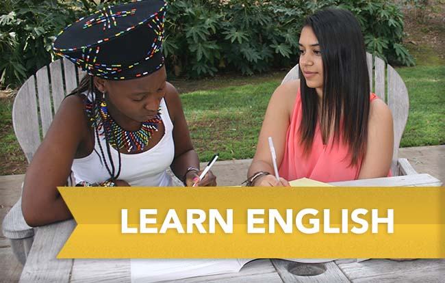 two female students studying English