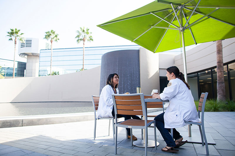 Nursing students sitting on the outside patio at the Park Place Campus