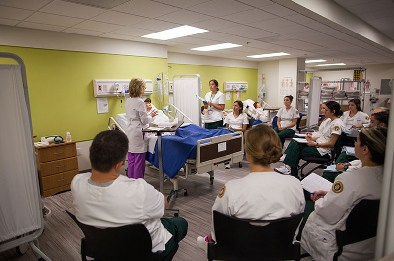 Nursing students watching a demonstration