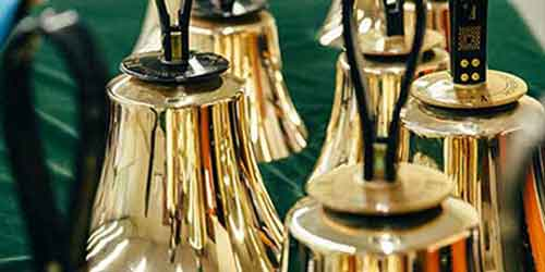 A close up of a group of golden handbells