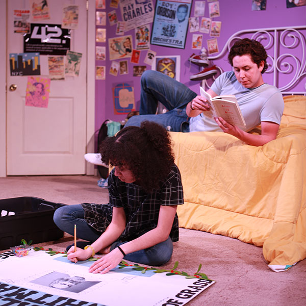 Two student during a scene on set