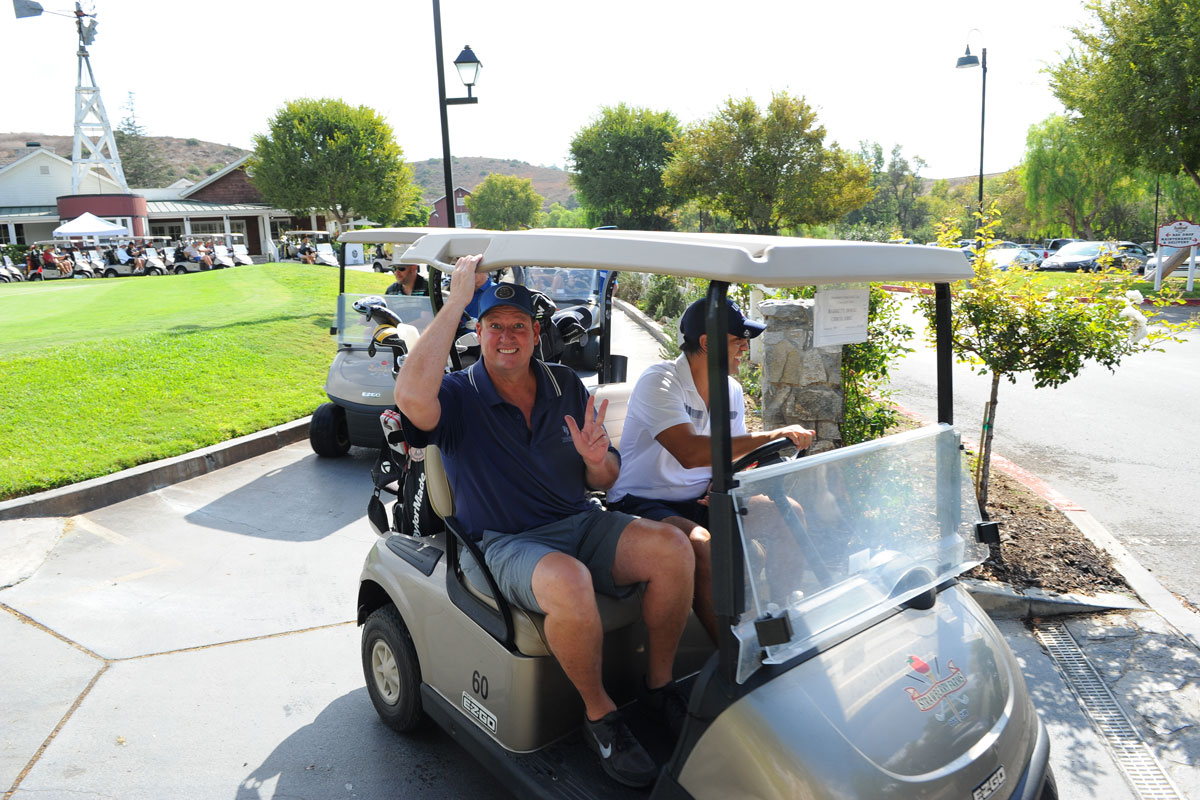 Attendees on the golf carts