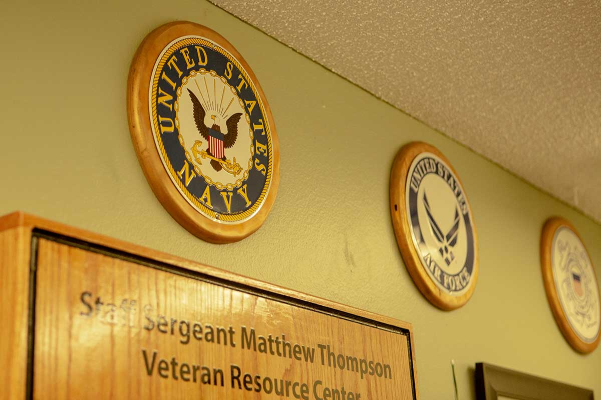 Military branches hanging on the wall