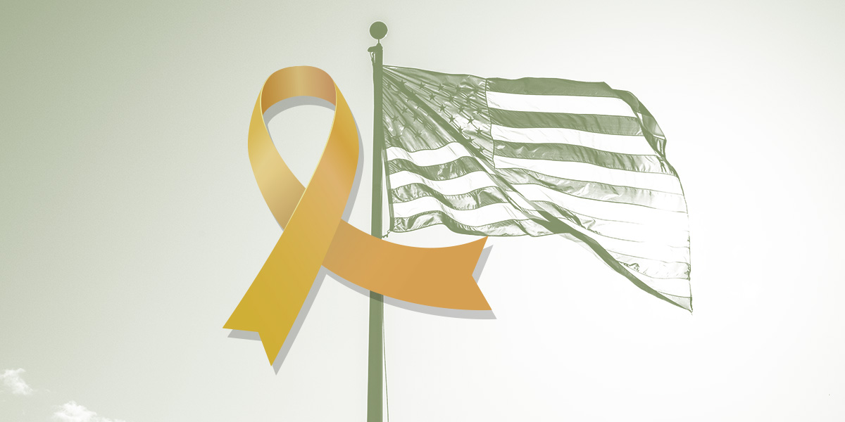 Yellow ribbon overlaying an image of the American flag