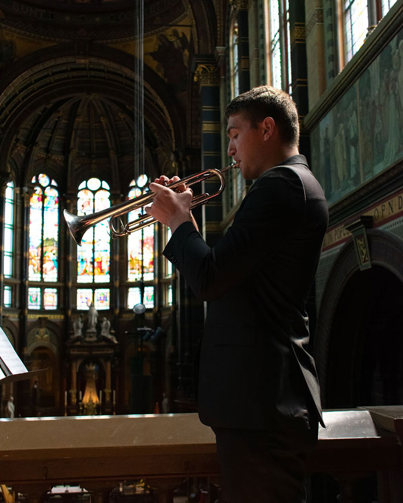 June 10: Jacob Lange performs a trumpet solo from the balcony of St. Nicholas Basilica (pc: Sam Held)