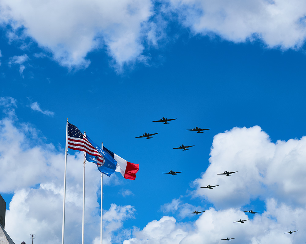 WWII bombers fly over Omaha Beach (photo credit: Brandon Dunivent)