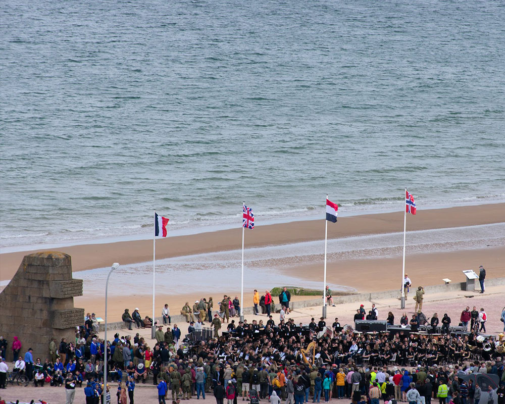 D-Day Memorial Wind Band performs on Omaha Beach (pc: Sam Held)