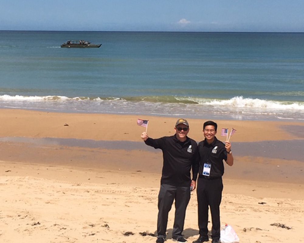 Dr. Held and Khoi Vu on Omaha Beach (photo credit: Nadine Leplat)