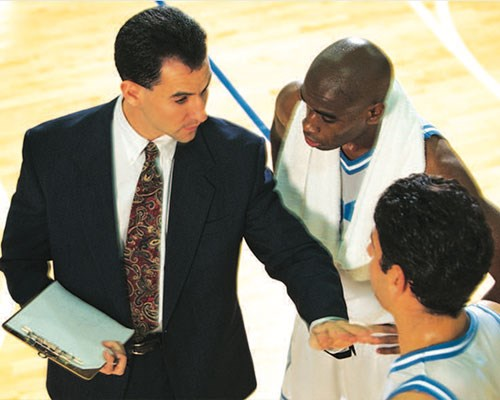 Basketball coach talking to his players